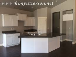 white kitchen cabinets black appliances dark brown kitchen