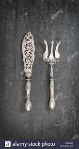 vintage silver cutlery on dark background retro kitchen utensils
