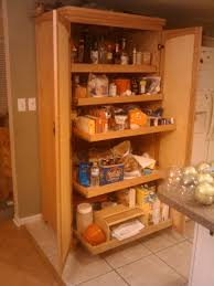 brown wooden pantry cabinet with four shelves having double doors furniture large white wooden pantry cabinet with two layers storage on