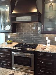 metal backsplashes for kitchens glossy black countertop caramel