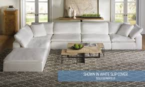 Sectional Sofa Slipcovers Cheap by Slip Covered Sofas Under A White Coffered Ceiling A Lovely Gray