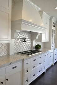 Limestone Backsplash Kitchen White Kitchen Cabinets Grey Countertops Some Patching Lamps Brown