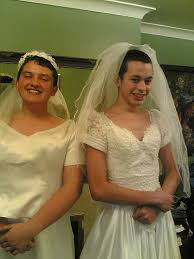 two boys dressed up as girls in wedding dresses cross dressing