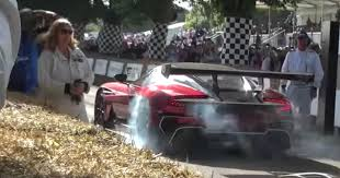 custom aston martin vulcan red aston martin vulcan does burnout at goodwood hill autoevolution