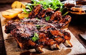 cuisiner travers de porc travers de porc sauce barbecue au miel intermarche belgique