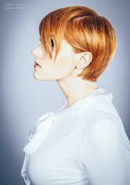 short hairstyles as seen from behind short dark blonde hair pushed behind the ear