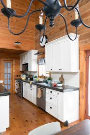 black kitchen cabinets in log cabin painted beadboard stained barstools creative cain cabin