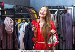 young woman red dress choosing shoes stock photo 533791399