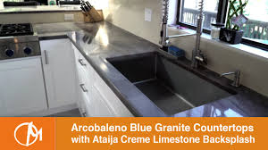 arcobaleno blue granite countertops with an ataija creme limestone arcobaleno blue granite countertops with an ataija creme limestone backsplash