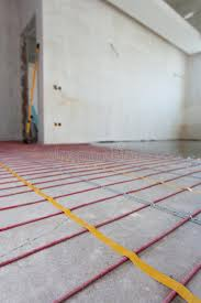 electric floor heating system installation in new house room with