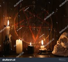 evil candles scary skull against wooden stock photo 450931714