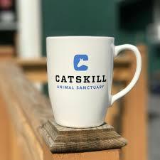 mug catskill animal sanctuary logo and tagline love spoken here