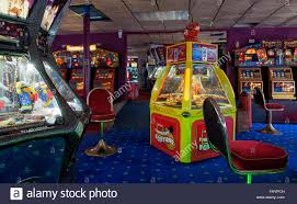 amusement penny arcade interior with slot machines uk stock