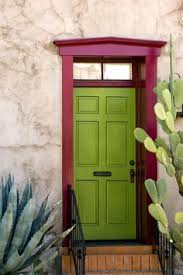 tucson home exterior blue stucco and purple front door cactus