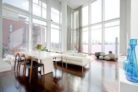 modern living room interior with high window panels and large modern living room interior with high window panels and large windows