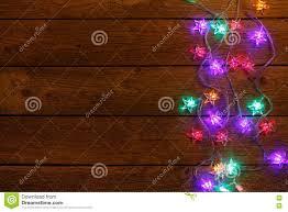 christmas lights border on wood background stock photo image