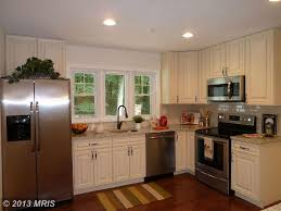 traditional kitchen with undermount sink u0026 simple granite counters