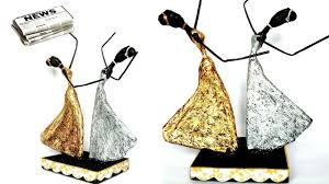 how to make dancing doll from newspaper and tissue paper african