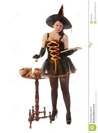 in halloween witch costume prepares a potion royalty free