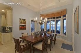 Transitional Dining Rooms Dining Room With Limestone Tile Floors U0026 High Ceiling In Palm