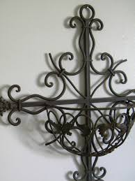 Wrought Iron Wall Planters by Wrought Iron Cross Wall Planter Half Basket Ornate What U0027s It Worth