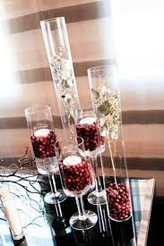 Vases With Floating Candles Picture Of Tall Vases Filled With Cranberries And Topped With