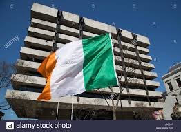 the irish flag in front of the central bank in dublin city