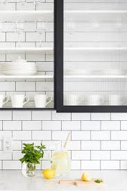 glass kitchen cabinets sliding doors black cabinets with rippled glass doors transitional kitchen
