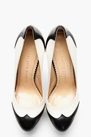 charlotte olympia ivory brogued leather dolly spectator pumps in