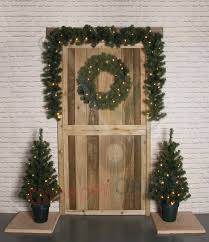 4 piece pre lit door christmas decoration kit with trees wreath