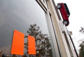 Houston City Flag Fate Of Hanging Mini Cooper Is Up In The Air Houston Chronicle