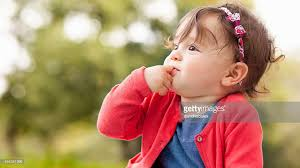 baby pictures baby girl outdoors on the grass stock photo getty images