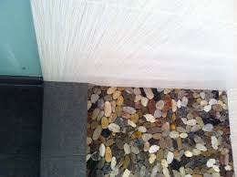 river rock bathroom ideas river rock tile wood look tile on standup shower walls with river