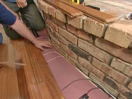 Laminate Flooring Threshold Trim How To Install Flooring Around A Fireplace How Tos Diy