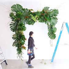 wedding arch leaves finishing touches tropical wedding arch pinteres