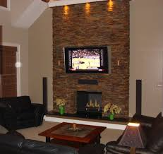 cool false ceiling lighting over stacked stone fireplace ideas