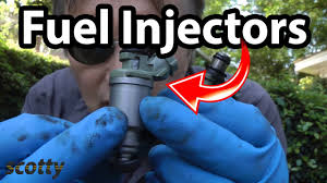 how to replace fuel injectors in your car diy with scotty kilmer