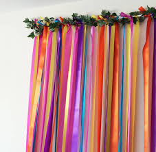Rainbow Curtain Rainbow Ribbon Backdrop On White Pole With Garland By Just Add