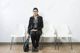 for a job interview anxious indian woman waiting for a job interview while sitting