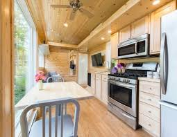 tiny home dining table inside this wooden tiny house is a gorgeous surprise this is
