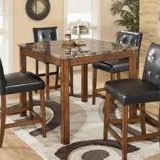 rent to own dining room tables rent to own ashley theo counter height dining room table rent one