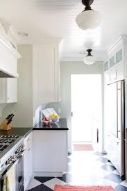 beadboard kitchen ceiling with schoolhouse pendants transitional