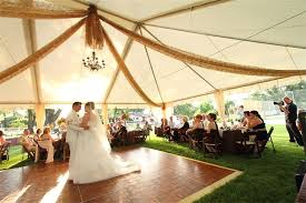 tent rental for wedding 4 way brown gossamer tent drape with hanging chandelier