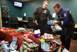 oregon city police respond to christmas 9 1 1 with gifts for needy