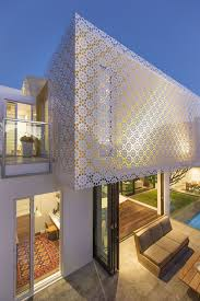 perforated building facades that redefine traditional design