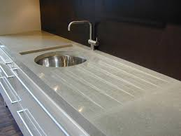 gray concrete countertop with integral drainboard and sink cutout