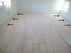 cheap kitchen floor ideas diy planked floors i purchased this primer and made a mixture of 1