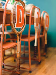 how to use vintage tennis rackets as varsity themed chair swags
