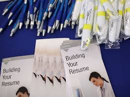 Free pens and resume building pamphlets are displayed