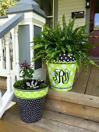 painted giant planters on porch steps great gardening ideas